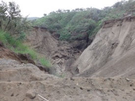 Side view of the washed away road. Image credit: Debbie Nightingale